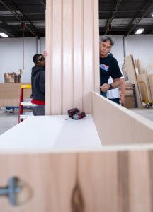 Kundig team members working on custom woodworking project